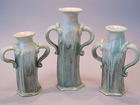 3 light blue vases with hands on hips