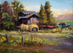 Rustic Wyoming ranch with hay bales and dilapidated truck
